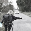 Travel - Backpacker hitching  a lift - Stock Photo