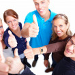 Group of casual friends giving thumbs up - Stock Photo