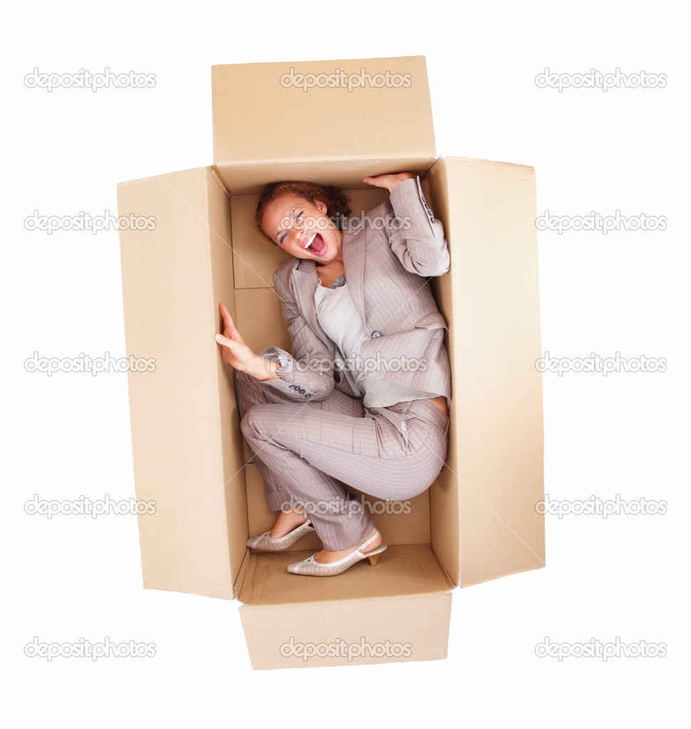 Top view of a frustrated young business woman in box isolated on white background  Stock Photo #3280442