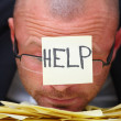 HELP -Overworked businessman - Foto Stock