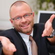 Royalty-Free Stock Photo: Business man presenting it for you