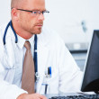 Medical - Handsome doctor using computer - Stock Photo