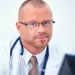 Royalty-Free Stock Photo: Medical - Friendly doctor looking at you