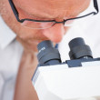 Royalty-Free Stock Photo: Science - Closeup of researcher using microscope