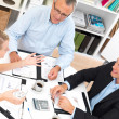 Business meetings - Busy talking and showing - Stock Photo