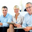 Freindly modern business sitting together -  