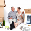 Mature couple relaxing after moving house - Stock Photo
