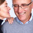 Royalty-Free Stock Photo: Happy woman whispering in her man\'s ear