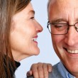 Royalty-Free Stock Photo: Closeup of a happy wife whispering in her husband\'s ear