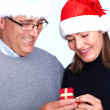 Royalty-Free Stock Photo: Happy man giving a Christmas present to his wife