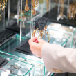 Royalty-Free Stock Photo: Hand touching bracelets in jewellery shop