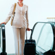 Business on the move -Woman travelling - Stock Photo