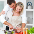 Modern romantic couple preparing a meal - Stock Photo