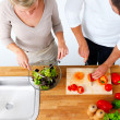 Royalty-Free Stock Photo: Young couple preparing food in a kitchen