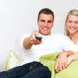 Royalty-Free Stock Photo: Modern lifestyle -  Couple sitting on  sofa using remote