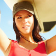 Beautiful young surfer chick carrying board - Stock Photo