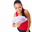 Portrait of a Happy young female holding cash - Stock Photo