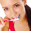 Royalty-Free Stock Photo: Attractive  young woman brushing her teeth isolated on white