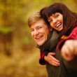 Royalty-Free Stock Photo: Closeup of a young romantic couple smiling with copyspace