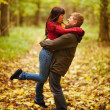 Royalty-Free Stock Photo: Happy woman jumping into mans arms in forest