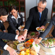 Business lunch - Group of businesspeople eating lunch - Stock Photo