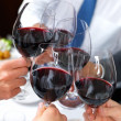 Closeup of toasting glass of whine - Stock Photo
