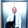 Royalty-Free Stock Photo: Closeup portrait of businessman standing with lift
