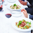 Business lunches - Food being eaten at a lunch - Stock Photo
