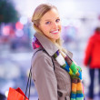 Royalty-Free Stock Photo: Young beautiful woman carrying shopping bag