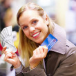 Beautiful young lady showing US bills and credit card - Lizenzfreies Foto