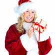 Royalty-Free Stock Photo: Isolated Beautiful female Santa holding a gift