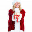 Royalty-Free Stock Photo: Charming female Santa presenting a Christmas gift