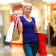 Royalty-Free Stock Photo: Young woman shopping in the mall
