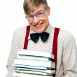 Royalty-Free Stock Photo: Nerdy student carrying stack of books on white