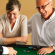 Royalty-Free Stock Photo: Mature couple gambling at casino