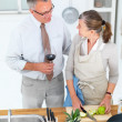 Royalty-Free Stock Photo: Lifestyles -  loving older couple in kitchen