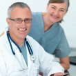 Mature doctor and nurse ready to help you - Stock Photo