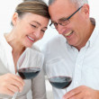 Royalty-Free Stock Photo: Mature joyful couple toasting wine