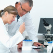 Royalty-Free Stock Photo: Scientists  analysing together in a lab