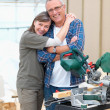 Happy mature couple renovating their home - Stock Photo