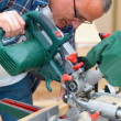 Carpenter using  an electric saw - Stock Photo