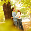 Royalty-Free Stock Photo: Romantic couple standing by  tree hugging