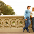 Royalty-Free Stock Photo: Romantic couple standing on bridge