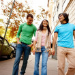 Royalty-Free Stock Photo: Portrait of three friends walking down the street