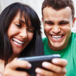 Royalty-Free Stock Photo: Couple laughing at modern mobile phone