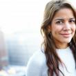 Royalty-Free Stock Photo: Modern hispanic woman smiling against copyspace