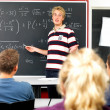 Royalty-Free Stock Photo: Student teaching mathematics equations to students