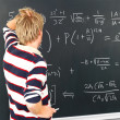 Modern education - Student looking at blackboard - Stock Photo