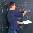 Royalty-Free Stock Photo: Student solving algebra on blackboard