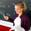 Royalty-Free Stock Photo: Attractive modern teacher teaching math